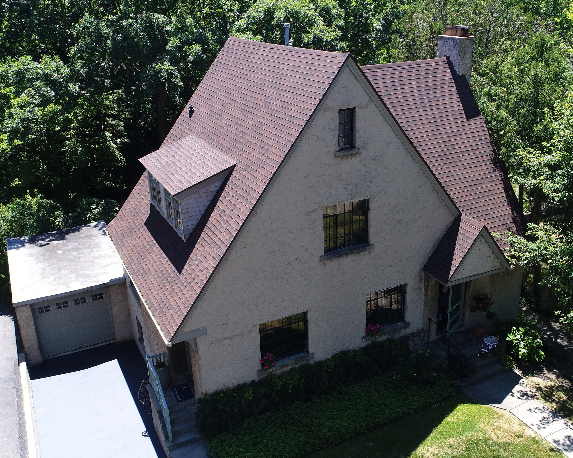 GAF Hickory shingles, steep roof, drone image, wicker gutters, A frame